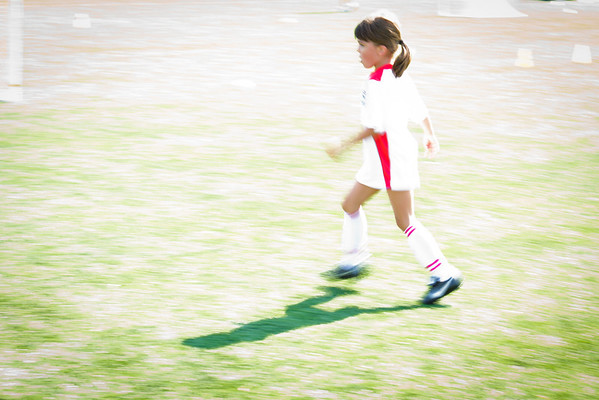 My daugther playing soccer during a weekend match.