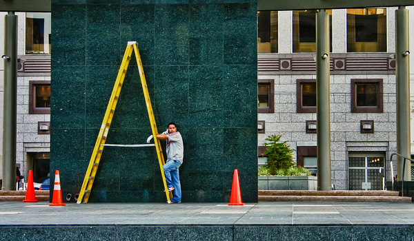 Man Holding Ladder