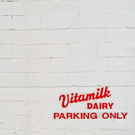 Parking sign outside of the administrative offices of Vitamilk Dairy in the Green Lake neighborhood of Seattle.